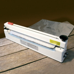 Impulse sealer with holding magnet and cutter